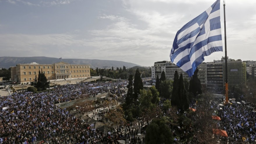 A huge Greek flag waves  in Athends, Greece. EPA, YANNIS KOLESIDIS