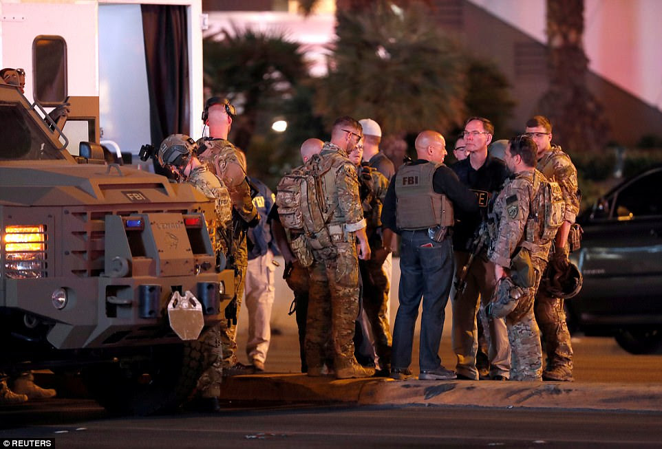 FBI agents confer in front of the Tropicana hotel-casino on October 2, 2017, after a mass shooting during a music festival on the Las Vegas Strip in Las Vegas, Nevada, U.S.