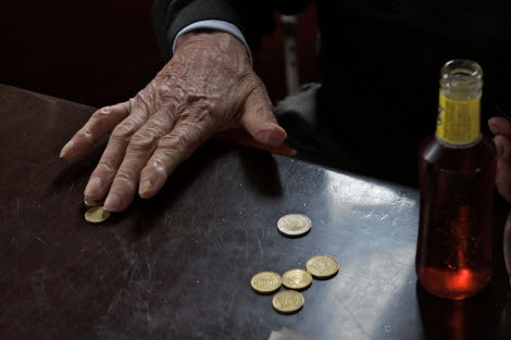 Contando monedas. | Carlos García Pozo