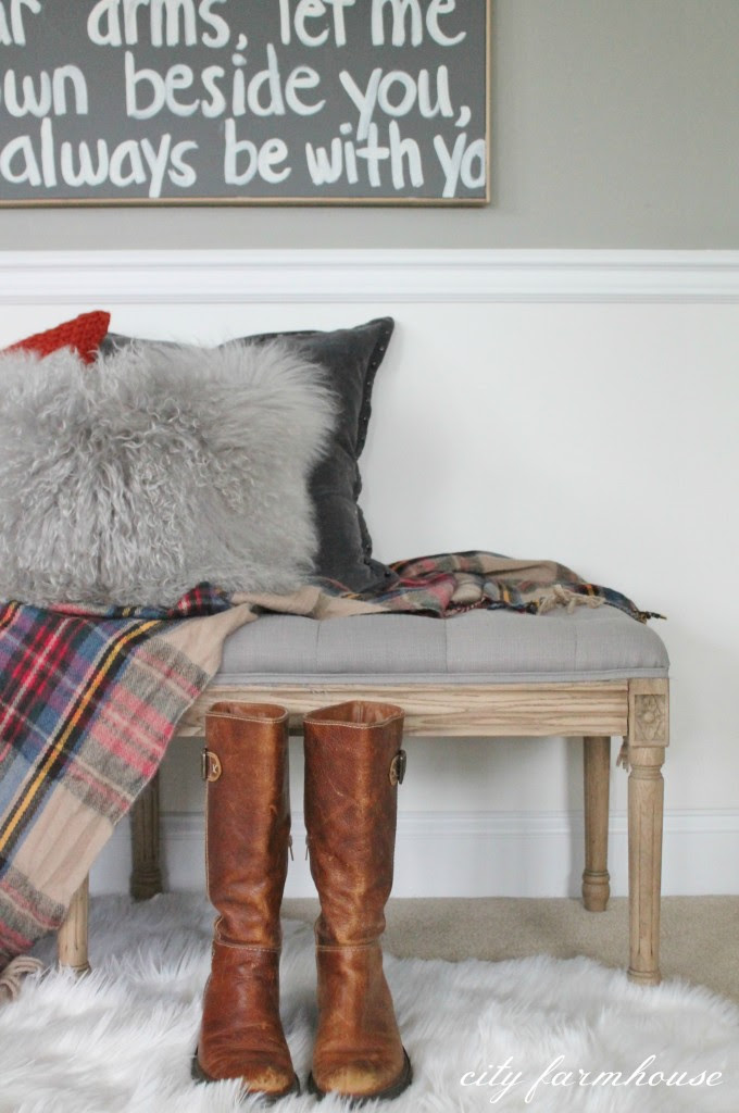 Cozy bench layered with wool throw & soft textured pillows