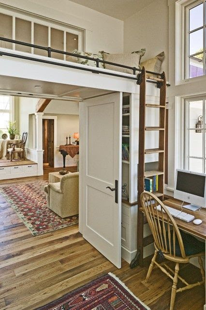 Loft - reading nook or guest bed, accessed by a library ladder.  This is a brilliant use of space!