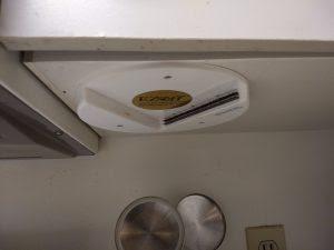 Jar opener installed under kitchen cabinet