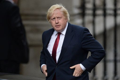 Boris Johnson walks to 10 Downing Street