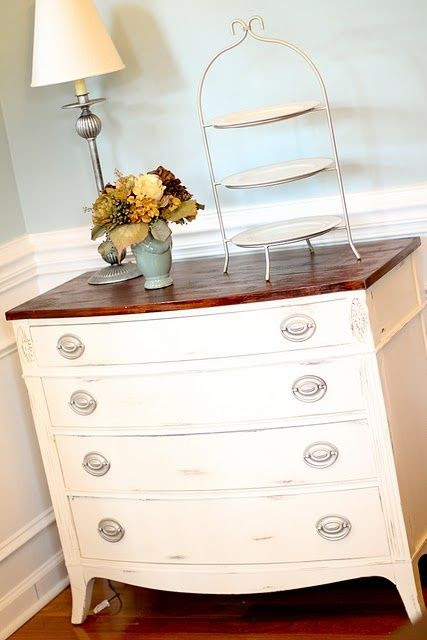 Pretty re-finished dresser placed in dining room -- and I like the paint color for a dining room, too.