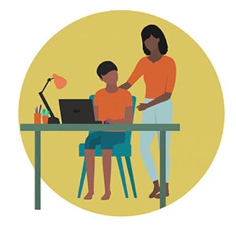 Woman talking to teen sitting at desk