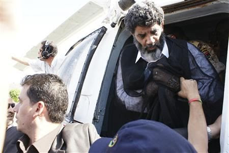 Former Libyan intelligence director Abdullah al-Senussi being unloaded by US-backed rebels after illegal extradition from Mauritania. $200 million was paid for his abduction. by Pan-African News Wire File Photos