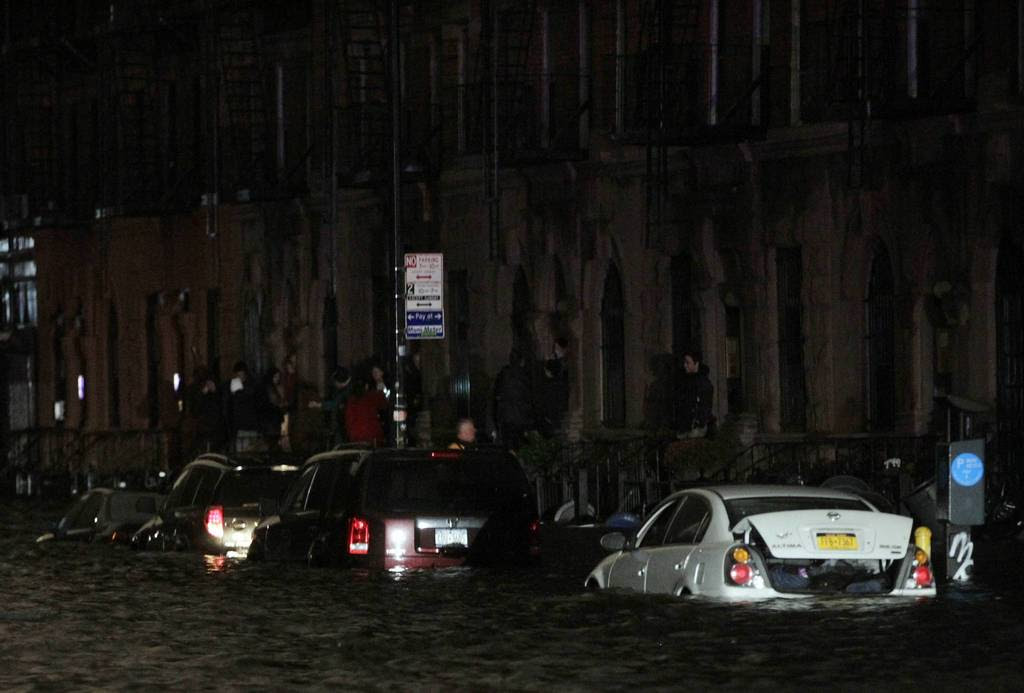 Flood waters brought on by Hurricane Sandy over run cars in New York's lower east side. Hurricane Sandy began battering the U.S. East Coast on Monday with fierce winds and driving rain, as the monster storm shut down transportation, shuttered businesses and sent thousands scrambling for higher ground hours before the worst was due to strike.