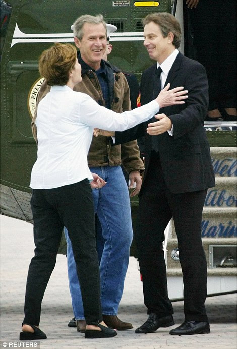 Big man? Blair's ego was flattered by the President during his visit to his ranch home. He is pictured above embracing First Lady Laura Bush