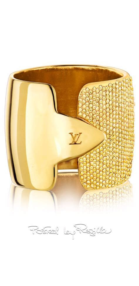 Louis Vuitton ring, gold finished brass metal micro paved