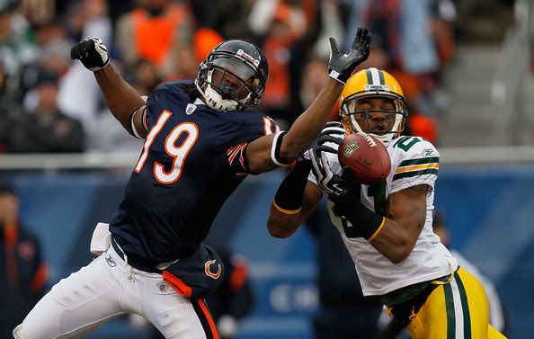 Devin Aromashodu Charles Woodson #21 of the Green Bay Packers breaks up a pass intended for Devin Aromashodu #19 of the Chicago Bears at Soldier Field on December 13, 2009 in Chicago, Illinois.