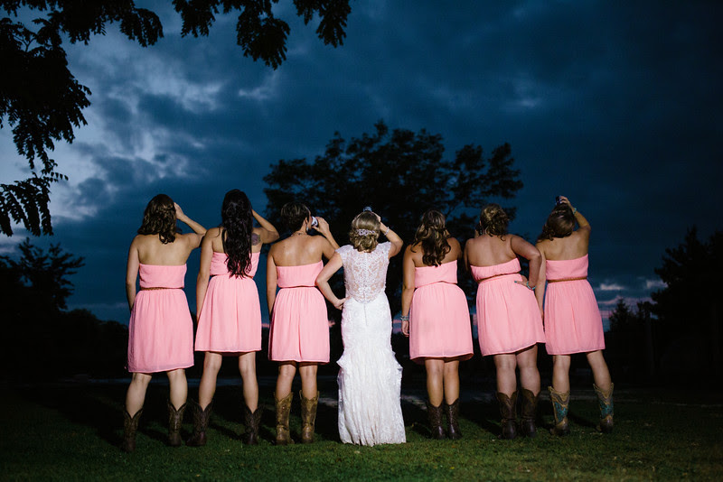 Bridesmaids and Bride Photographs taken at night at Williams Tree farm in Rockton IL, Located about 20 minutes north of Rockford IL. The Wedding was a anniversary and vow renewal held for friends and family. They had many DIY and rustic country elements in their wedding and reception. Photo by Mindy Joy Photography. Tilting back beer cans.