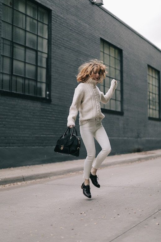 Le Fashion Blog Cable Knit Turtleneck Sweater White Jeans Leather Brogues Black Bag Via Sea Of Shoes