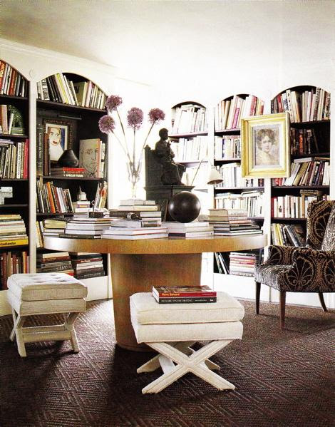 Suzie: Eclectic office space  Round wood table, brown black patterned wing back wingback chair, ...