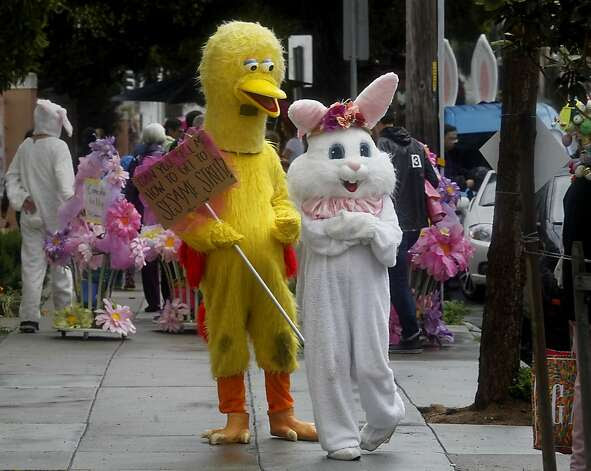 Big Bird and the Easter Bunny waited on a side street for the parade to begin. The 22nd annual Easter Parade and Spring Celebration on Union Street in San Francisco, Calif. attracted thousands of people on a slightly rainy day Sunday March 31, 2013. Photo: Brant Ward, The Chronicle