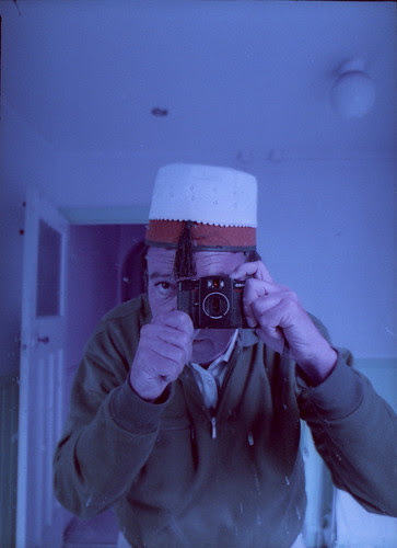 reflected self-portrait with LC-W camera and hybrid Fez by pho-Tony