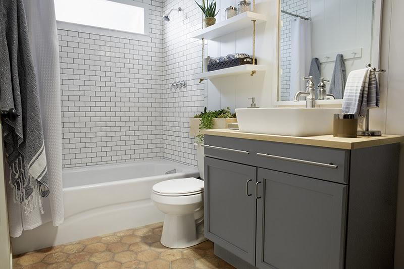a builder grade bathroom transformation with Lowe's ...