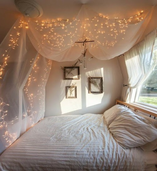 soft canopy bed + fairylights = cuteness!