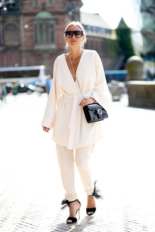 Le Fashion Blog Cfw Street Style Pajama Dressing Trend For Summer White Belted Robe Top Matching Pants Celine Sunglasses Black Leather Gucci Crossbody Bag Ankle Wrapped Sandals with Chiffon Detail Via British Vogue