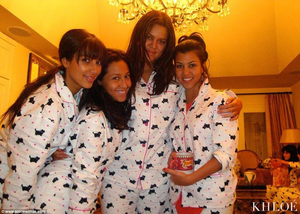 Relaxed: She's seen in white, pink and black jammies, along with her family members clad in the exact same set