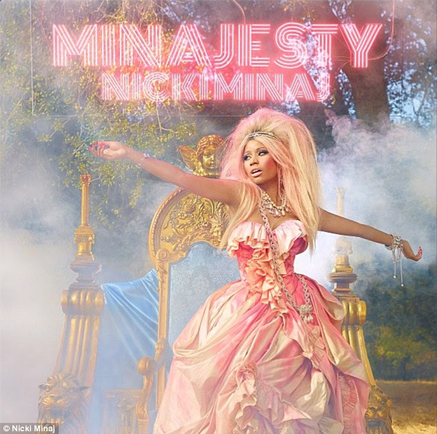 Fragrance royalty: Nicki Minaj shares a promotional image of herself dressedf as a queen advertising her new scent, Minajesty
