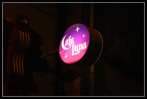 Cafe Luna sign at nighttime - pink and purple, with a half-moon for the letter C, and some stars around the edge