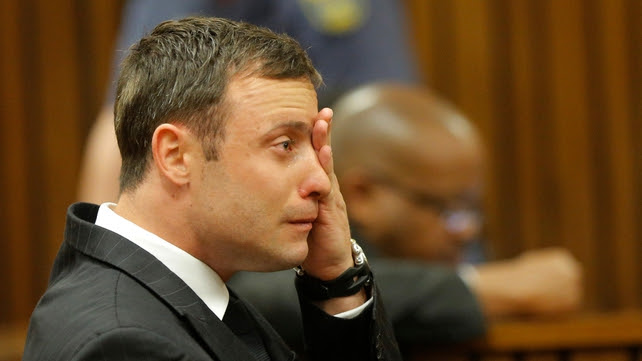 Oscar Pistorius wipes away a tear during today's proceedings in court