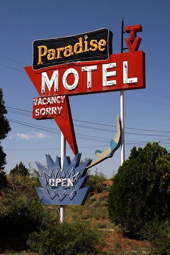 the paradise motel neon sign