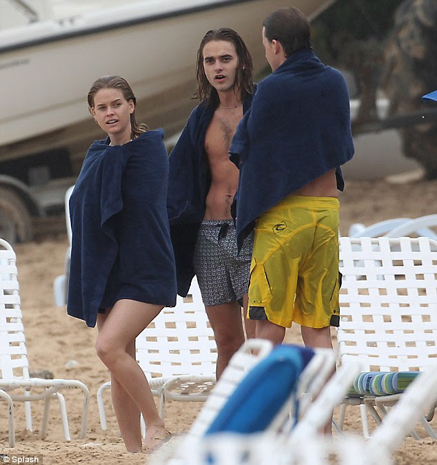 Giggles all round: Back on dry land, the siblings continued their fun, and seemed to be poking fun at each other as they chuckled away while wrapped in cosy navy blue towels