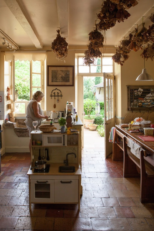 A Classic, traditional French kitchen. Note the children's 'range' in foreground, and the stone sink (evier) under the window on the lef