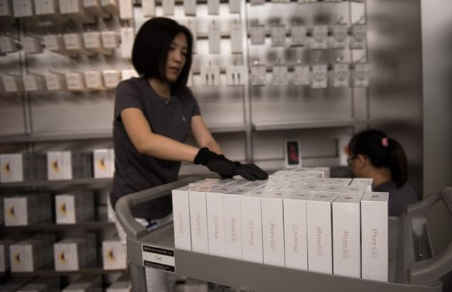 <p>Your job went to China and all you got was an iPhone.</p>  Photographer: JOHANNES EISELE/AFP/Getty Images