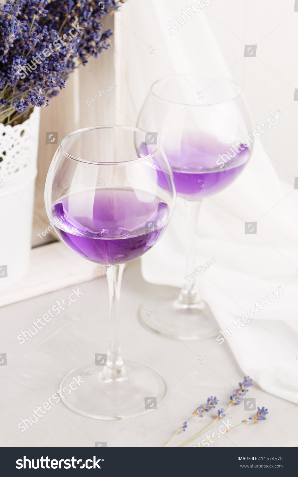 http://www.shutterstock.com/pic-411574570/stock-photo-lavender-cocktail-on-white-background-romantic-concept-shallow-focus.html