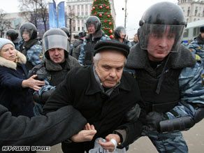 Police detain a demonstrator at a political opposition rally in Moscow.