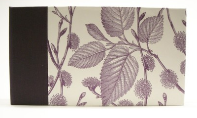 handmade album with picture of leaves on the cover