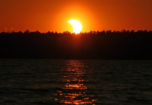 The partially eclipsed sun sets over Island Lake north of Duluth, Minn. on May 20, 2012. Credit: Jim Schaff