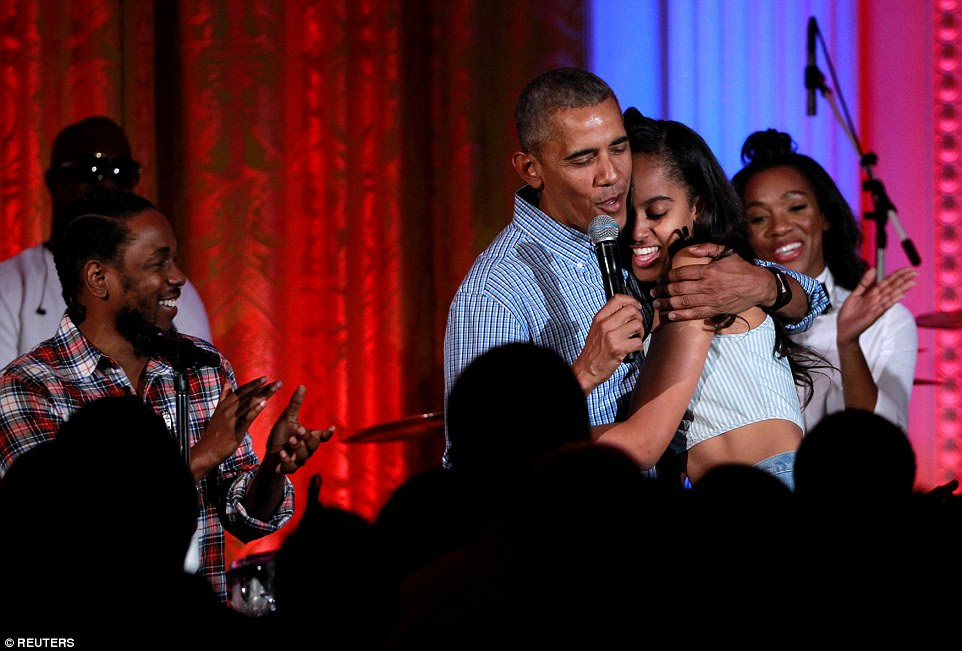 The chart-topping artists applauded Obama as he finished the song and gave his daughter a big hug on stage