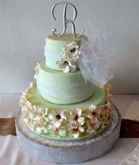Light Green 3 Tier Round Wedding Cake White Flowers
