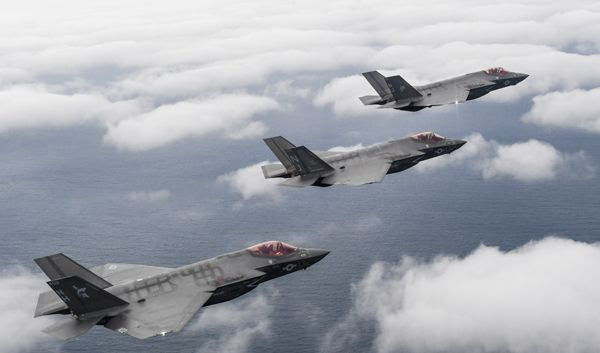 Three F-35C Lightning II aircraft fly in formation off the coast of Florida on February 1, 2019.
