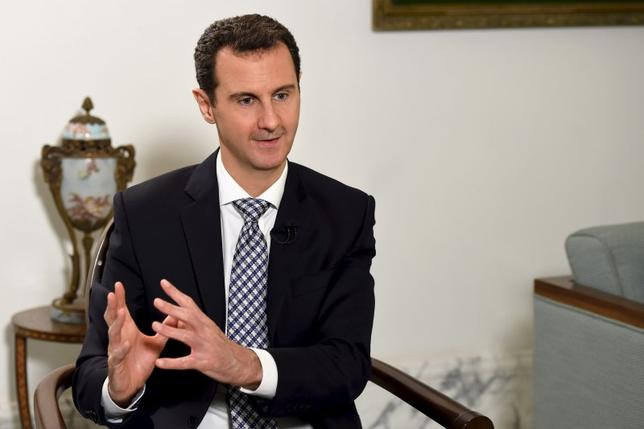 Syria's President Bashar al-Assad speaks during an interview with Spanish newspaper El Pais in Damascus, in this handout picture provided by SANA on February 20, 2016. Picture taken February 20, 2016. REUTERS/SANA/Handout via Reuters