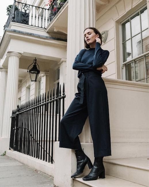 Le Fashion Blog 2 Cool Girl Looks Navy Mock Neck Sweater Navy High Waist Tie Waist Trousers Black Heeled Boots Via @wideeyedlegless