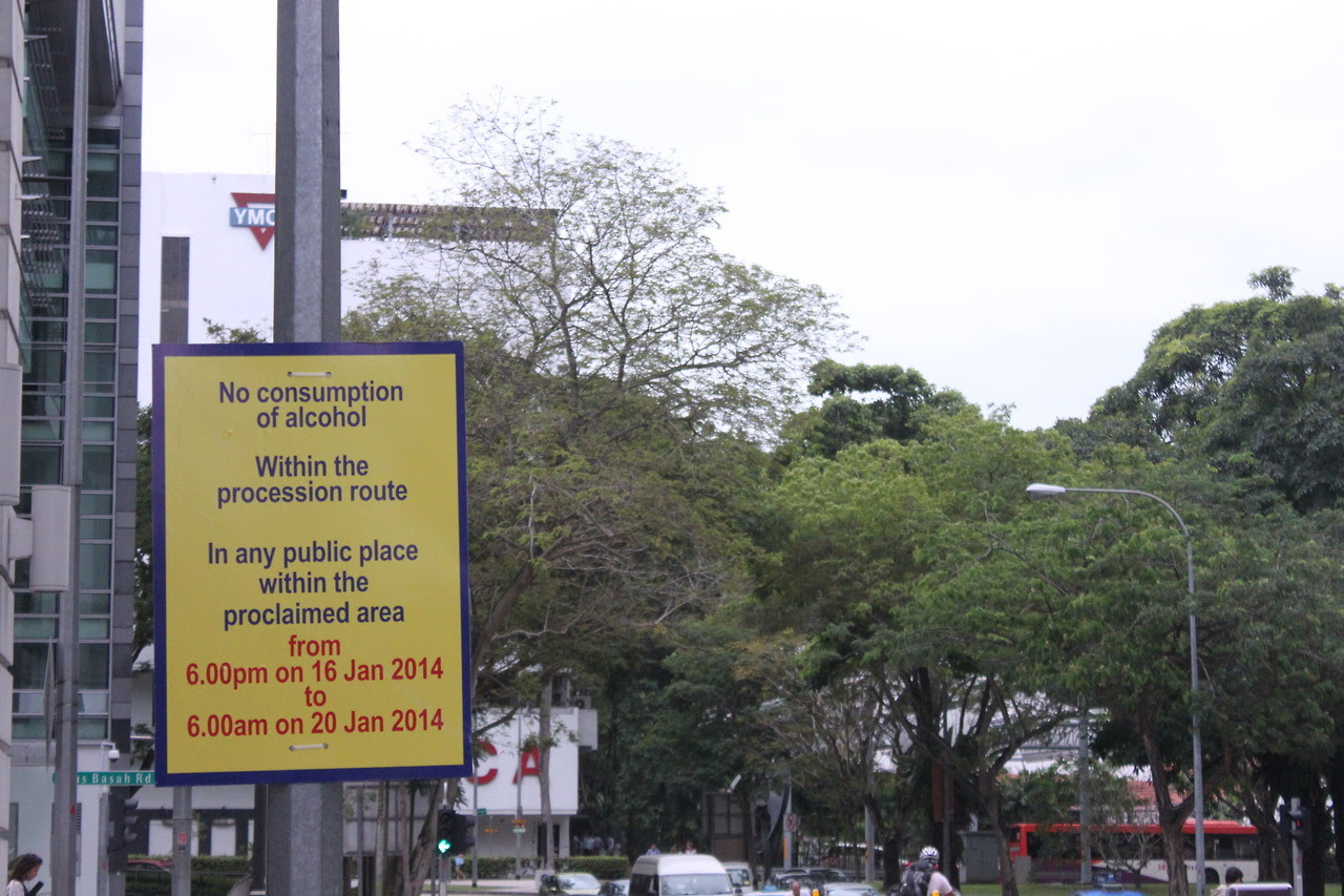 "Picture of the week: A signboard declares the Thaipusam route in 2014 to be a proclaimed area where public drinking is banned Since the 2011 ban on music from boomboxes, drums and gongs mandated by the Hindu Endowments Board in 2011, another ban has been in place for Thaipusam this year - a ban on public drinking. The festival, which commemorates the occasion when the goddess Parvathi gave her son Murugan a spear (Vel) to vanquish an evil demon Soorapadam, is celebrated by Hindus in Malaysia and Singapore. No apparent reason has been given for the ban - an AsiaOne report only quoted the police as saying that they had consulted with the Hindu Endowments Board and Little India Shopkeepers & Heritage Association, and that both organisations had been in favour of the ban. The ban seems misplaced, for it is unclear why anyone would drink in a religious procession. The ban is ostensibly an extension of the ban on public drinking in Little India in response to the riots in Little India in early December 2013 - but why? The restriction on music has already left people sore. Playwright Alfian Sa'at commented on a Facebook post: ""(Any) kind of harmony that is achieved through a regime of silence is only a facade of harmony, something watched on a screen with the mute button on."" What would more restrictions bring? Will this be a start to things that are much worse?"
