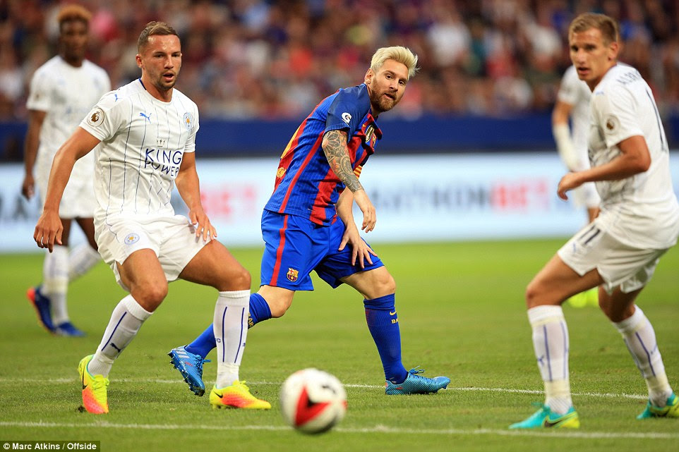 Lionel Messi watches the ball bobble loose as Marc Albrighton and Danny Drinkwater close the Argentine down