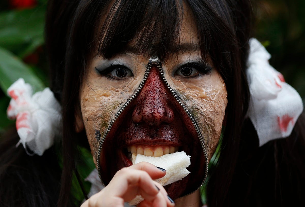 A participant in costume eats a sandwich after a Halloween parade in Kawasaki, south of Tokyo, on Oct. 26. More than 100,000 spectators turned up to watch the parade, where 2,500 participants dressed up in costumes.