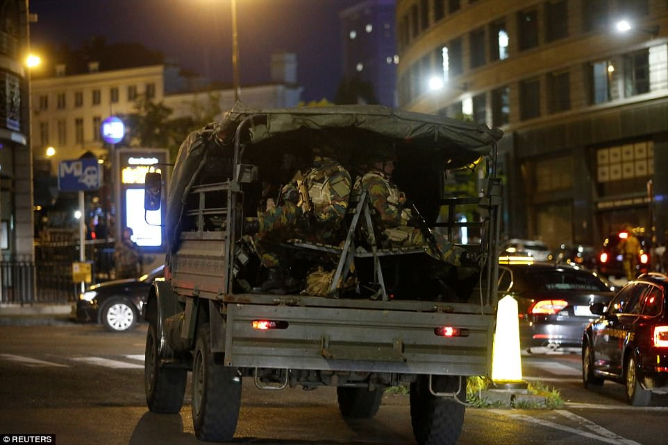 Belgian troops take up position in a truck inside the capital after the blast inside the busy station