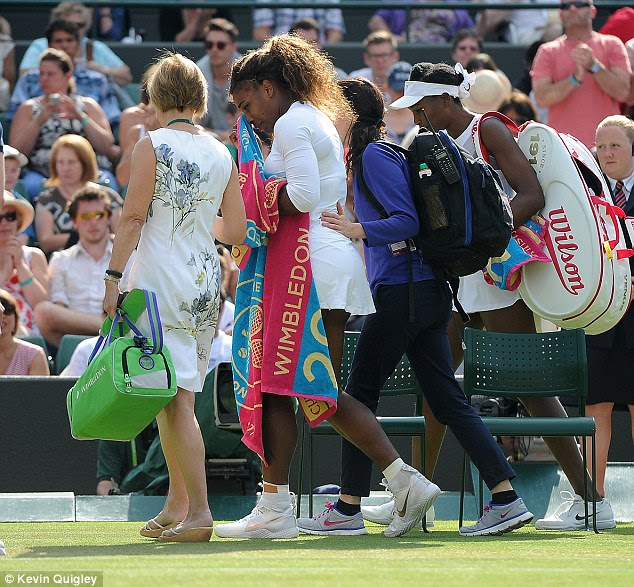 Williams retires from the match with illness and is helped off the court by medical staff