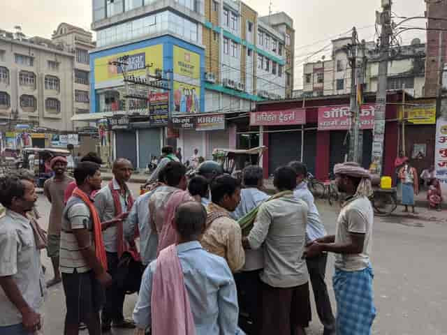 At Dinkar Chowk in Patna, daily wage labourers pounch on the motorcyclist looking for any menial job. Firstpost/Devparna Acharya
