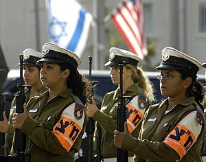 Israeli military police women stand in formati...