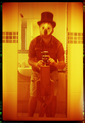 reflected self-portrait with Kershaw Penguin camera, top hat and owl mask by pho-Tony