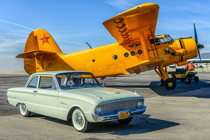 Antonov AN-2 biplane and classic car