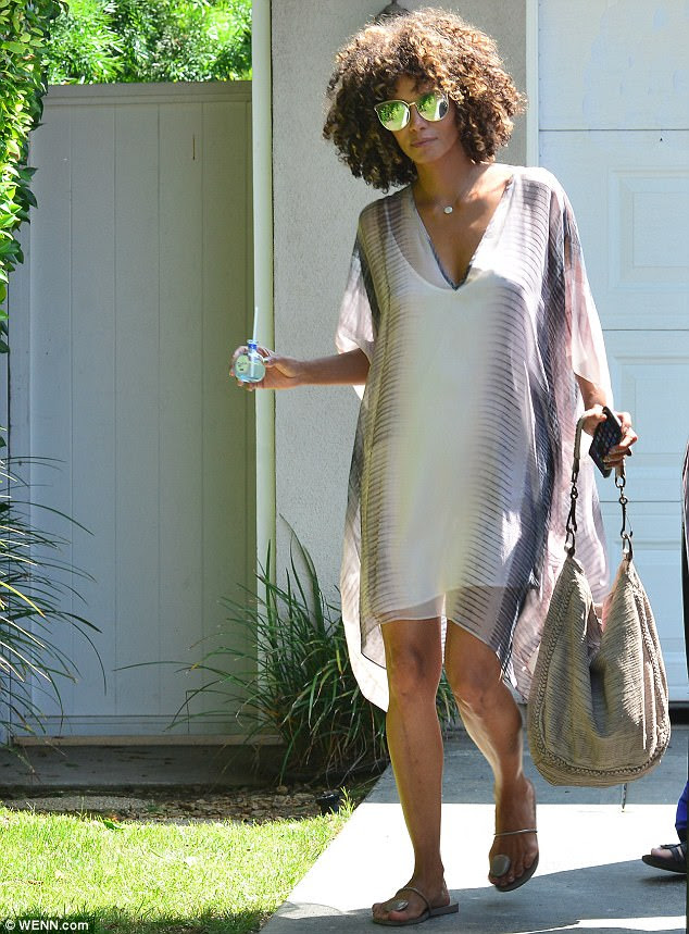 Gorgeous guest: Halle Berry, 50, was a vision on Sunday as she left the star-studded 19th Annual Day of Indulgence Party in Brentwood