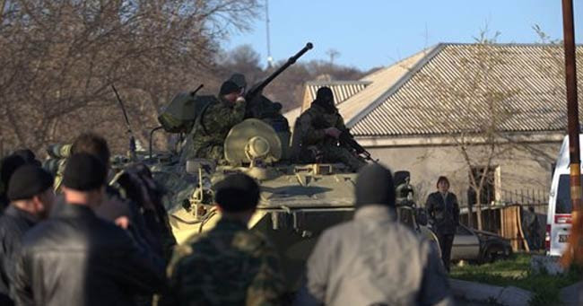 Armoured vehicles break into Ukraine base in Crimea, shots fired